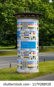 """Weimar, Thuringia, Germany - May 26 2017: A german advertising column (german: """"Litfaßsäule"""", named upon the inventor) on the compound of Bauhaus University Weimar"""