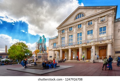 Weimar, Thuringia, Germany - September 25, 2018: Monument to Goethe and Schiller in front of the building of the German National Theater on the Theater Square.