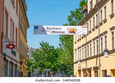 """Weimar, Thuringia, Germany-25.06.2019: Beatiuful city center of Weimar. The main street with logo of famous """"Bauhaus"""" Museum of Weimar"""