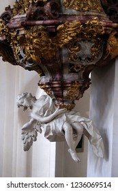WEINGARTEN, GERMANY - JULY 12, 2018: The pulpit carrying angel, pulpit in the Basilica of St. Martin and Oswald in Weingarten, Germany