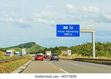 "Weinsberg, Germany - June 28, 2017: Highway A6 (Autobahn) near town Weinsberg, interchange ""Kreuz Weinsberg"""