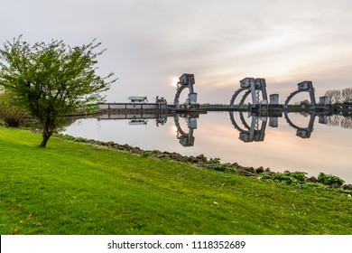 Weir near the islland of Maurik  in the Netherlands during sunset. It is a part of the weir complex Amerongen, consisting of locks, a weir and a fishway in the Rhine river (Nederrijn).