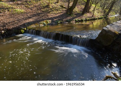 Weir on a small river in the forest, water landscape - Shutterstock ID 1961956534