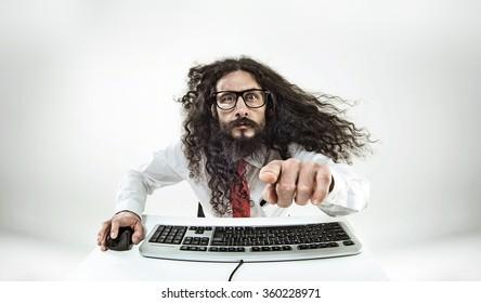 Weird computer geek with keyboard