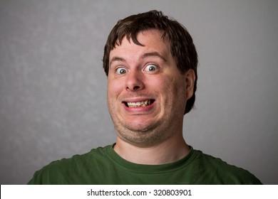 Weird face by a weird looking wide eyed man