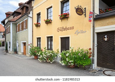 WEISSENKIRCHEN IN DER WACHAU, AUSTRIA - JULY 8, 2018. Old charming hotel decorated with flowers. Flag with the inscription in German: free room. Weissenkirchen in der Wachau, Lower Austria, Europe.