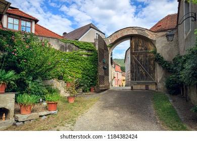 WEISSENKIRCHEN IN DER WACHAU, AUSTRIA - JULY 8, 2018. Vine-covered country courtyard. Weissenkirchen in der Wachau, district of Krems-Land, Lower Austria, Europe.