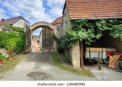 WEISSENKIRCHEN IN DER WACHAU, AUSTRIA - JULY 8, 2018. Courtyard of the heuriger house - Austrian traditional wine tavern. Weissenkirchen in der Wachau, district of Krems-Land, Lower Austria, Europe.