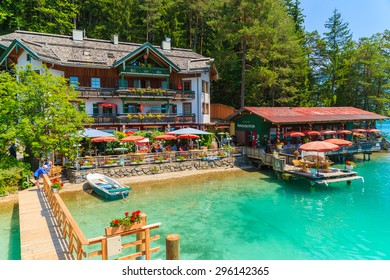 WEISSENSEE LAKE, AUSTRIA - JUL 7, 2015: restaurant and guest house on shore of Weissensee lake in summer time. Weissensee has drink quality of water and is highest situated bathing lake in Carinthia.