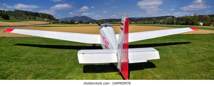 WEIZ/ AUSTRIA APR 24, 2017: Sailplane, glider airplane wide angle shot on the ground field waiting for take-off