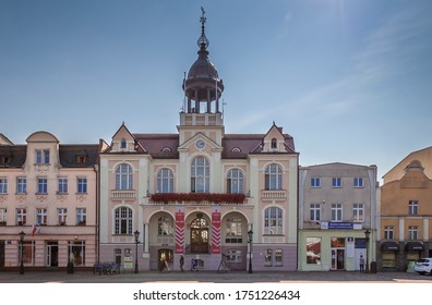 Wejherowo, Pomerania Province/Poland — 08.29.2019: Old town square (Jakub Wejher Square). View on the Town Hall, built 1908 in the Empire style. On the ground floor constituency office of PiS party.