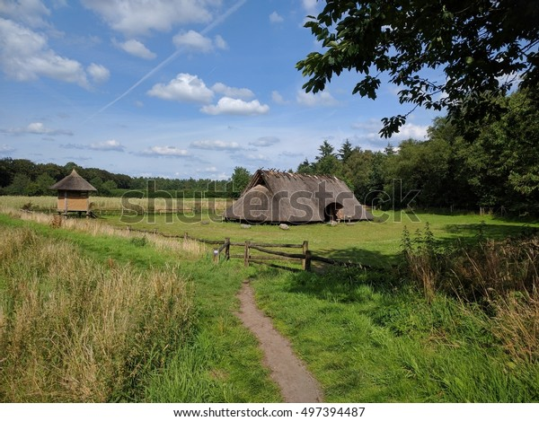 WEKEROM, THE NETHERLANDS - JULY 2016: a reconstructed iron age settlement, a celtic farmhouse and celtic fields at forest edge