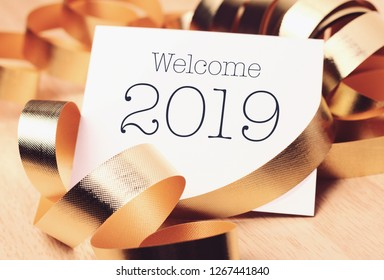 Welcome 2019 with decoration and the ribbon. We wish you a new year filled with wonder, peace, and meaning.