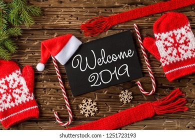 WELCOME 2019 handwritten inscription. Winter holiday composition. New Year and Christmas celebration. Winter holidays concept. Christmas decorations. Top View.