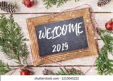 Welcome 2019. New Year concept.  The inscription 2019 on a chalkboard. Winter holidays concept.  Top View. Space for text