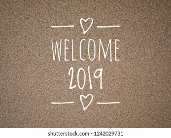 Welcome 2019 text on wooden background