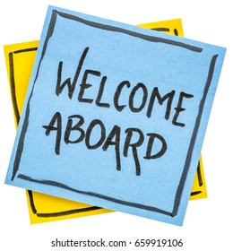 Welcome aboard  - handwriting on an isolated sticky note