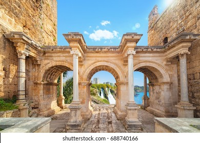 Welcome to amazing Antalya concept. Collage of famous landmarks: Hadrian's Gate old town Kaleici district and lower Duden waterfall in popular resort city Antalya, Turkey
