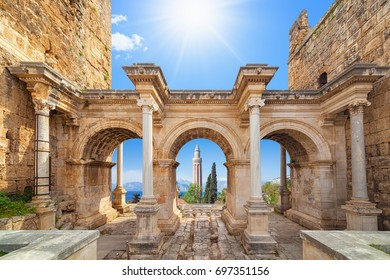 Welcome to amazing Antalya concept. Collage of famous landmarks: Hadrian's Gate old town Kaleici district and Yivli Minare Mosque or Alaaddin Mosque in popular resort city Antalya, Turkey