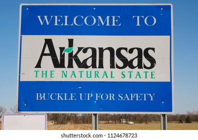 Welcome to Arkansas - the Natural Sate in front of blue sky