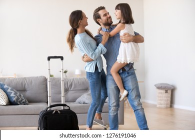 Welcome back dad concept, happy father businessman embracing kid child daughter and young wife returning from business trip, loving daddy arriving coming home excited by family reunion concept