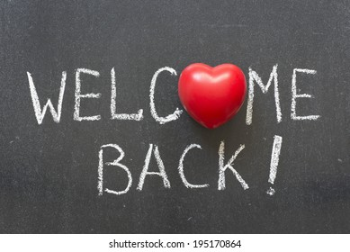 welcome back phrase handwritten on chalkboard with heart symbol instead of O
