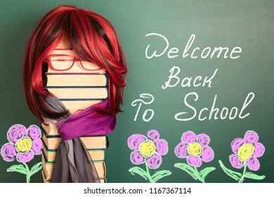 Welcome back to school! Education funny concept with unusual female teacher from books