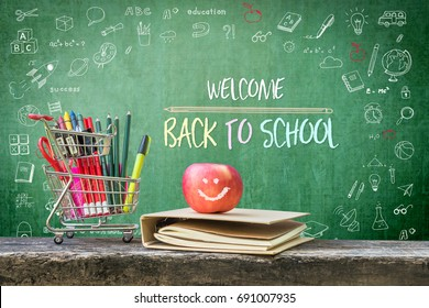 Welcome back to school, educational greeting announcement for students and teacher on green chalkboard with creative kid's doodle drawing and stationary supplies, book and apple