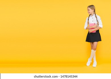 Welcome back to school. Inspirational quotes motivate kids for academic year ahead. School girl formal uniform hold book. School lesson. Study literature. Towards knowledge. Learn following rules.
