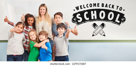 Welcome back to school on whiteboard next to a group of kids with a teacher