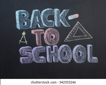 Welcome Back To School Typographical Background On Chalkboard With School Icon Elements