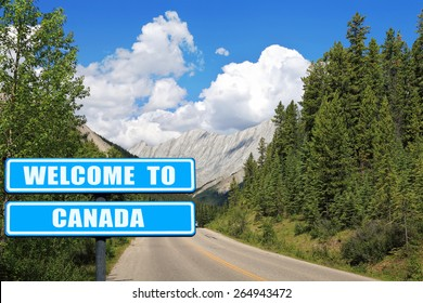 """""""Welcome to Canada """"  Blue road sign against  beautiful Canadian nature landscape with Rocky Mountains. Invitation to Canada ( visit and travel)"""