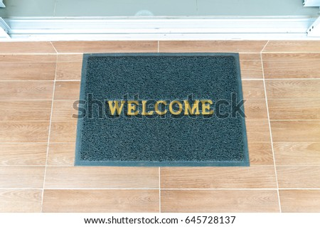 Welcome Carpet At The Front Of The Door.