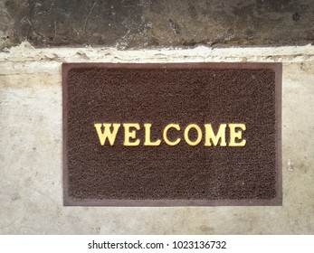 Welcome carpet gray color on old cement floor vintage background