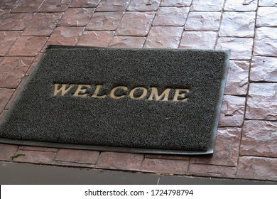 Welcome carpet gray color on floor.