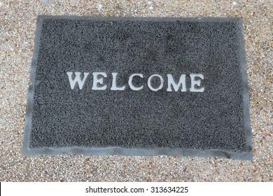 welcome carpet on floor