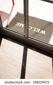 Welcome carpet and Silhouette door