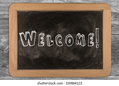 Welcome! - chalkboard with outlined text - on wood