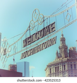 """""""Welcome to Chinatown"""" sign in Chinatown, New York City, USA on October, 7, 2015. Pastel vintage Instagram style filter with vignette applied."""