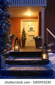 Welcome Christmas - house entrance snowy steps and door with decoration