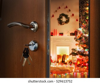 Welcome to christmas. Opening door to decorated holiday interior with fireplace, garland lights and christmas tree.