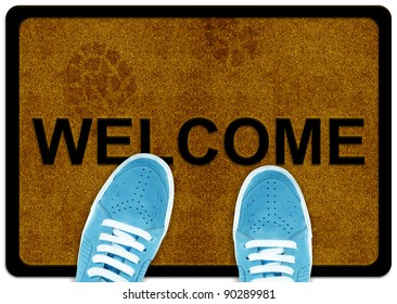 welcome cleaning foot carpet with shoes and shoe print on it.