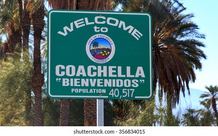 Welcome to Coachella, California road sign with palm trees backdrop