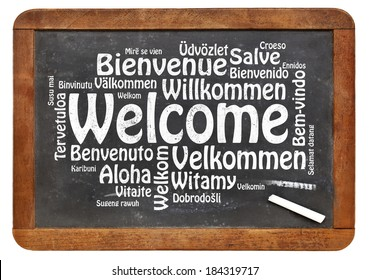 Welcome in different languages - a word cloud in white chalk text on a vintage slate blackboard isolated on white
