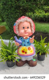 Welcome Doll stucco or clay doll for home gardening.