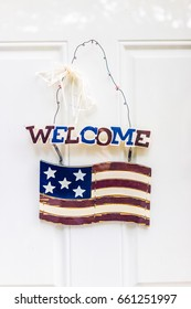 Welcome door hanging sign with American Flag and red, white and blue patriotic colors