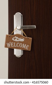 welcome door sign on the door handle