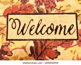 Welcome doormat with Fall leaves.