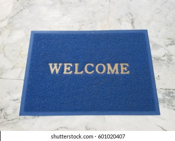 welcome doormat at the public library on marble floor