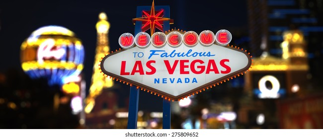 Welcome to Fabulous Las Vegas Neon Sign. Intentional Blurred Las Vegas Strip In Background